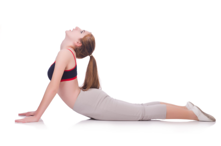 young woman doing exercises on white at home